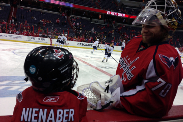 Capitals goaltender Braden Holtby chats with 8-year-old Braden Nienaber during warmups at the Capitals game on Jan. 12. Nienaber's wish, granted through The Children's Wish Foundation of Canada, was to meet Holtby.