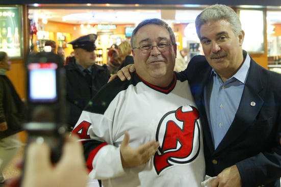 NEWARK, NJ - APRIL 15: Jeff Vanderbeek, co-owner and managing partner of the New Jersey Devils, poses with a fan at Newark Penn Station on his way to Game 1 of the Stanley Cup Playoff Eastern Conference Quarterfinals between the Carolina Hurricanes and the New Jersey Devils on April 15, 2009 at the Prudential Center in Newark, New Jersey.  (Photo by Andy Marlin/NHLI via Getty Images)