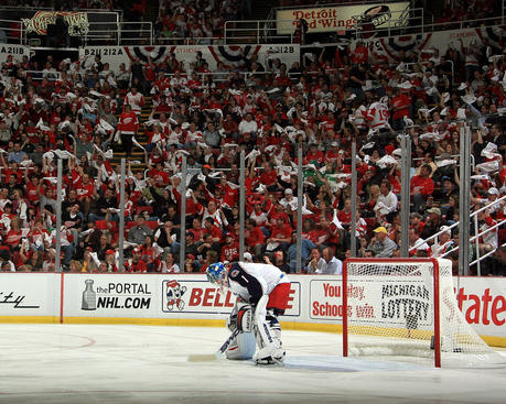 DETROIT - APRIL 18:  Goalie Steve Mason #1 of the Columbus Blue Jackets gets ready to start Game Two of the Western Conference Quarterfinals of the 2009 NHL Stanley Cup Playoffs while the home Detroit Red Wing fans wave their towels on April 18, 2009 at Joe Louis Arena in Detroit, Michigan  (Photo by Dave Reginek/NHLI via Getty Images)