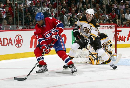 MONTREAL - APRIL 20: Georges Laraque #17 of the Montreal Canadiens stickhandles the puck against Zdeno Chara #33 of the Boston Bruins during Game Three of the Eastern Conference Quarterfinal Round of the 2009 Stanley Cup Playoffs at the Bell Centre on April 20, 2009 in Montreal, Quebec, Canada.  (Photo by Andre Ringuette/NHLI via Getty Images)