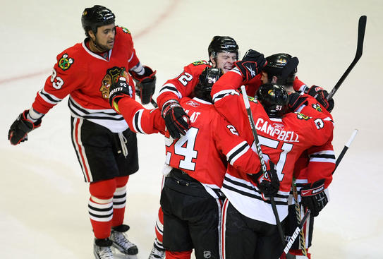 CHICAGO - APRIL 25: (L-R) Dustin Byfuglien #33, Martin Havlat #24, Kris Versteeg #32 and Brian Campbell #51 of the Chicago Blackhawks celebrate a first period goal by teammate Brent Seabrook #7 against the Calgary Flames during Game Five of the Western Conference Quarterfinals of the 2009 Stanley Cup Playoffs on April 25, 2009 at the United Center in Chicago, Illinois. (Photo by Jonathan Daniel/Getty Images)