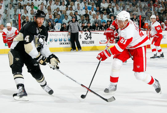 Rob Scuderi of the Pittsbrugh Penguins deflects the shot by Marian Hossa of the Detroit Red Wings during Game Four of the 2009 Stanley Cup Final.  (Photo by Dave Sandford/NHLI via Getty Images)