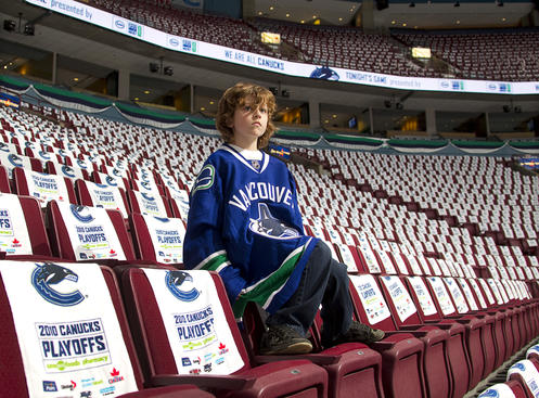VANCOUVER, CANADA - APRIL 15: White towels cover the seats as a young fan sits in the stands prior to the start of Game One of the Western Conference Quarterfinals between the Los Angeles Kings and the Vancouver Canucks during the 2010 Stanley Cup Playoffs at General Motors Place on April 15, 2010 in Vancouver, British Columbia, Canada. (Photo by Jeff Vinnick/NHLI via Getty Images)