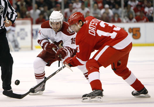 DETROIT - APRIL 18: Matthew Lombardi #15 of the Phoenix Coyotes battles for the puck with Pavel Datsyuk #13 of the Detroit Red Wings during Game Three of the Western Conference Quarterfinals of the 2010 NHL Stanley Cup Playoffs on April 18, 2010 at Joe Louis Arena in Detroit, Michigan. (Photo by Gregory Shamus/Getty Images)