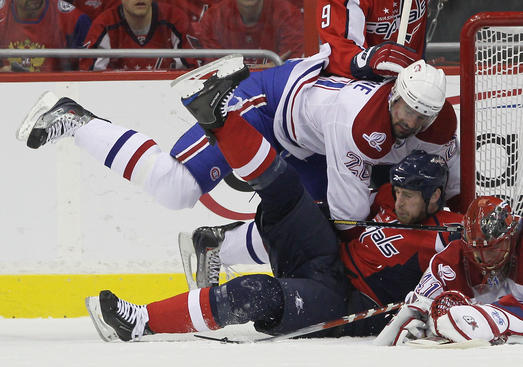 WASHINGTON - APRIL 28: Ryan O'Byrne #20 of the Montreal Canadiens takes down Brooks Laich #21 of the Washington Capitals in Game Seven of the Eastern Conference Quarterfinals during the 2010 NHL Stanley Cup Playoffs at the Verizon Center on April 28, 2010 in Washington, DC. (Photo by Bruce Bennett/Getty Images)