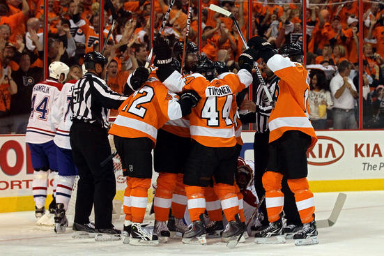 PHILADELPHIA - MAY 16: Braydon Coburn #5 and the Philadelphia Flyers celebrates after his goal in the first period against the Montreal Canadiens in Game1 of the Eastern Conference Finals during the 2010 NHL Stanley Cup Playoffs at Wachovia Center on May 16, 2010 in Philadelphia, Pennsylvania. (Photo by Jim McIsaac/Getty Images)