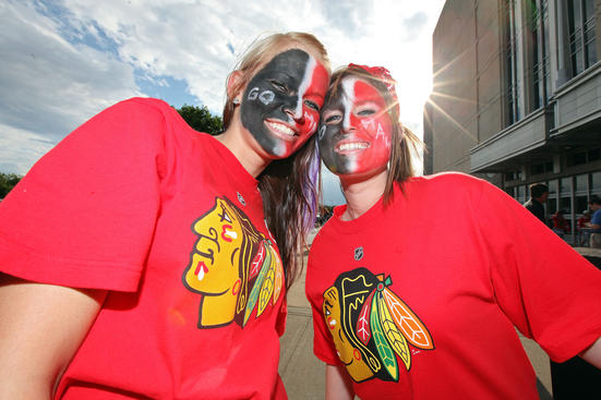 CHICAGO - JUNE 06: Fans of the Chicago Blackhawks pose outside before Game Five of the 2010 NHL Stanley Cup Final at the United Center on June 6, 2010 in Chicago, Illinois. (Photo by Andre Ringuette/Getty Images)