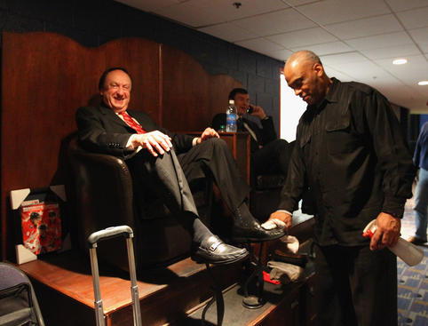 WASHINGTON, DC - APRIL 15: Broadcasters Sam Rosen and Joe Micheletti get a shoe shine inside the Verizon Center prior to the game between the Washington Capitals and the New York Rangers in Game Two of the Eastern Conference Quarterfinals during the 2011 NHL Stanley Cup Playoffs on April 15, 2011 in Washington, DC. (Photo by Bruce Bennett/Getty Images)
