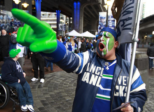 VANCOUVER, CANADA - APRIL 11:  Vancouver Canucks fan Paul Hans cheers outside Rogers Arena before the start of Game One of the Western Conference Quarterfinals between the Los Angeles Kings and the Vancouver Canucks during the 2012 NHL Stanley Cup Finals at Rogers Arena on April 11, 2012 in Vancouver, British Columbia, Canada.  (Photo by Jeff Vinnick/NHLI via Getty Images)