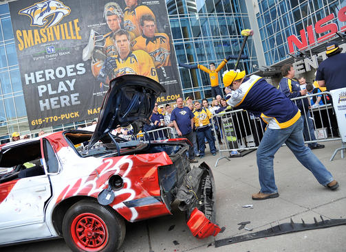 NASHVILLE, TN - APRIL 13: Fans of the Nashville Predators take swings at a Red Wings painted car on the plaza before Game Two of the Western Conference Quarterfinals against the Detroit Red Wings during the 2012 NHL Stanley Cup Playoffs at the Bridgestone Arena on April 13, 2012 in Nashville, Tennessee. (Photo by John Russell/NHLI via Getty Images)