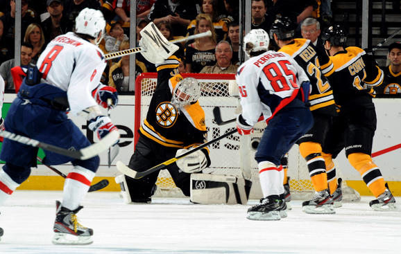 BOSTON, MA - APRIL 14: Tim Thomas #30 of the Boston Bruins makes a save against the Washington Capitals in Game Two of the Eastern Conference Quarterfinals during the 2012 NHL Stanley Cup Playoffs at TD Garden on April 14, 2012 in Boston, Massachusetts. (Photo by Steve Babineau NHLI via Getty Images)