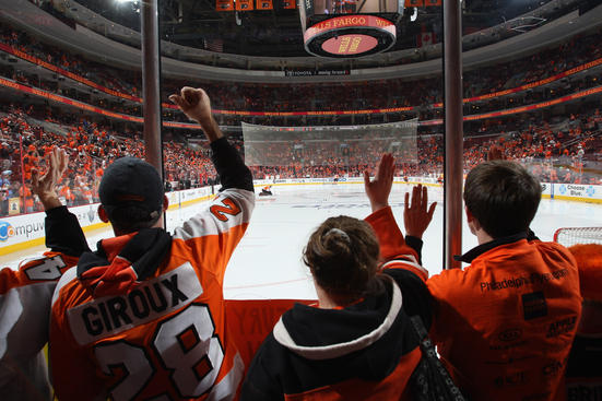 PHILADELPHIA, PA - APRIL 18: Philadelphia Flyers fans cheer on their team as they skate in warmups prior to playing the Pittsburgh Penguins in Game Four of the Eastern Conference Quarterfinals during the 2012 NHL Stanley Cup Playoffs at Wells Fargo Center on April 18, 2012 in Philadelphia, Pennsylvania.  (Photo by Bruce Bennett/Getty Images)