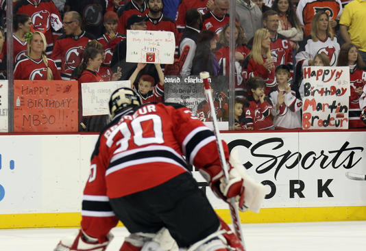 NEWARK, NJ - MAY 06: Martin Brodeur #30 of the New Jersey Devils is welcomed by fans with signs commemorating his 40th birthday during warmups prior to playing against the Philadelphia Flyers in Game Four of the Eastern Conference Semifinals during the 2012 NHL Stanley Cup Playoffs at Prudential Center on May 6, 2012 in Newark, New Jersey.  (Photo by Bruce Bennett/Getty Images)