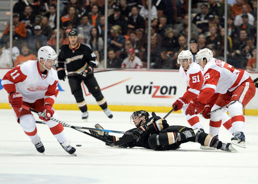 ANAHEIM, CA - APRIL 30:  Bobby Ryan #9 of the Anaheim Ducks falls to the ice between Daniel Cleary #11, Valtteri Filppula #51 and Niklas Kronwall #55 of the Detroit Red Wings in Game One of the Western Conference Quarterfinals during the 2013 Stanley Cup Playoffs at Honda Center on April 30, 2013 in Anaheim, California.  (Photo by Harry How/Getty Images)