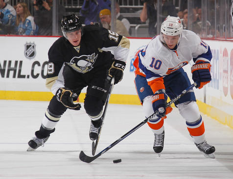 PITTSBURGH, PA - MAY 1:  Keith Aucoin #10 of the New York Islanders moves the puck in front of Beau Bennett #19 of the Pittsburgh Penguins in Game One of the Eastern Conference Quarterfinals during the 2013 NHL Stanley Cup Playoffs at Consol Energy Center on May 1, 2013 in Pittsburgh, Pennsylvania.  (Photo by Gregory Shamus/NHLI via Getty Images)