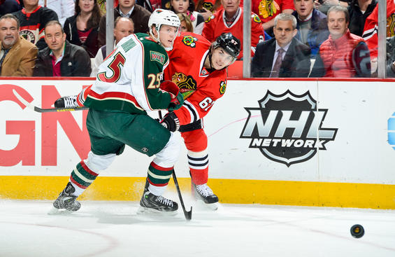 CHICAGO, IL - MAY 3: Michael Frolik #67 of the Chicago Blackhawks shoots the puck past Jonas Brodin #25 of the Minnesota Wild in Game Two of the Western Conference Quarterfinals during the 2013 Stanley Cup Playoffs at the United Center on May 03, 2013 in Chicago, Illinois. (Photo by Bill Smith/NHLI via Getty Images)