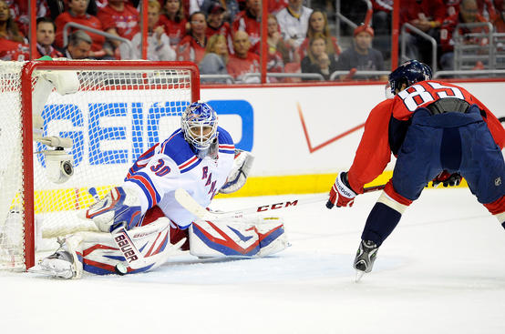 WASHINGTON, DC - MAY 04:  Henrik Lundqvist #30 of the New York Rangers makes a save in the first period against Mathieu Perreault #85 of the Washington Capitals in Game Two of the Eastern Conference Quarterfinals during the 2013 NHL Stanley Cup Playoffs at Verizon Center on May 4, 2013 in Washington, DC.  (Photo by Greg Fiume/Getty Images)