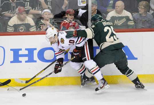 ST PAUL, MN - MAY 7: Patrick Sharp #10 of the Chicago Blackhawks controls the puck against Jonas Brodin #25 of the Minnesota Wild during the first period of Game Four of the Western Conference Quarterfinals during the 2013 NHL Stanley Cup Playoffs at Xcel Energy Center on May 7, 2013 in St Paul, Minnesota. (Photo by Hannah Foslien/Getty Images)