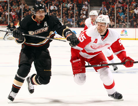 ANAHEIM, CA - MAY 12: Teemu Selanne #8 of the Anaheim Ducks battles for position against Niklas Kronwall #55 of the Detroit Red Wings in Game Seven of the Western Conference Quarterfinals during the 2013 NHL Stanley Cup Playoffs at Honda Center on May 12, 2013 in Anaheim, California. (Photo by Debora Robinson/NHLI via Getty Images)