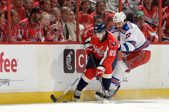 WASHINGTON, DC - MAY 13:  Mathieu Perreault #85 of the Washington Capitals and Brian Boyle #22 of the New York Rangers get physical along the boards during the first peiod of Game Seven of the Eastern Conference Quarterfinals during the 2013 NHL Stanley Cup Playoffs at Verizon Center on May 13, 2013 in Washington, DC.  (Photo by Patrick McDermott/NHLI via Getty Images)