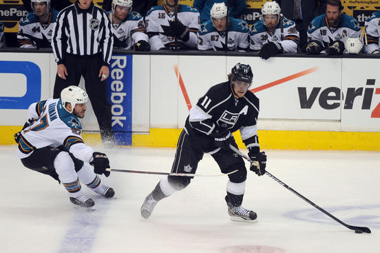LOS ANGELES, CA - MAY 16: Anze Kopitar #11 of the Los Angeles Kings handles the puck against Scott Hannan #27 of the San Jose Sharks in Game Two of the Western Conference Semifinals during the 2013 NHL Stanley Cup Playoffs at Staples Center on May 16, 2013 in Los Angeles, California. (Photo by Evan Gole/NHLI via Getty Images)