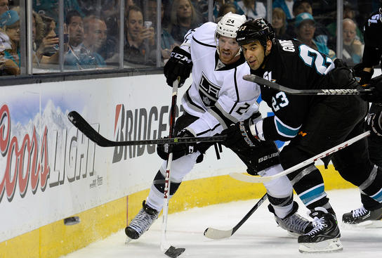 SAN JOSE, CA - MAY 21:  Colin Fraser #24 of the Los Angeles Kings battles for control of the puck with Scott Gomez #23 of the San Jose Sharks in the first period in Game Four of the Western Conference Semifinals during the 2013 NHL Stanley Cup Playoffs at HP Pavilion on May 21, 2013 in San Jose, California.  (Photo by Thearon W. Henderson/Getty Images)