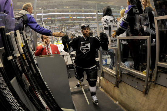 LOS ANGELES, CA - MAY 23:  Rob Scuderi #7 of the Los Angeles Kings leaves the ice after warming up prior to the game against the San Jose Sharks in Game Five of the Western Conference Semifinals during the 2013 NHL Stanley Cup Playoffs at Staples Center on May 23, 2013 in Los Angeles, California. (Photo by Andrew D. Bernstein/NHLI via Getty Images)