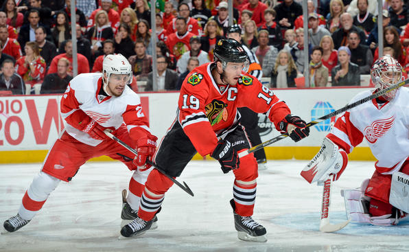 CHICAGO, IL - MAY 25: Jonathan Toews #19 of the Chicago Blackhawks and Brendan Smith #2 of the Detroit Red Wings watch for the puck next to goalie Jimmy Howard #35 of the Red Wings in Game Five of the Western Conference Semifinals during the 2013 Stanley Cup Playoffs at the United Center on May 25, 2013 in Chicago, Illinois. (Photo by Bill Smith/NHLI via Getty Images)