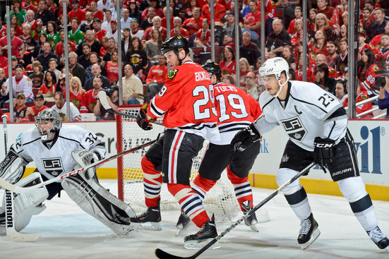 CHICAGO, IL - JUNE 1: Bryan Bickell #29 of the Chicago Blackhawks and Dustin Brown #23 of the Los Angeles Kings watch for the puck next to goalie Jonathan Quick #32 of the Kings in Game One of the Western Conference Final during the 2013 Stanley Cup Playoffs at the United Center on June 01, 2013 in Chicago, Illinois. (Photo by Bill Smith/NHLI via Getty Images)