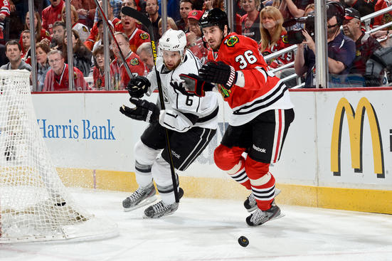 CHICAGO, IL - JUNE 8: Jake Muzzin #6 of the Los Angeles Kings and Dave Bolland #36 of the Chicago Blackhawks chase after the puck in Game Five of the Western Conference Final during the 2013 Stanley Cup Playoffs at the United Center on June 08, 2013 in Chicago, Illinois. (Photo by Bill Smith/NHLI via Getty Images)