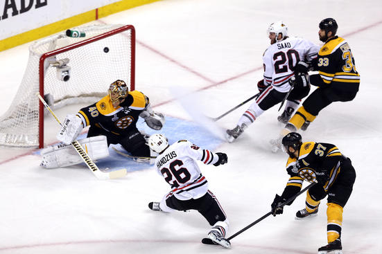BOSTON, MA - JUNE 19:  Michal Handzus #26 of the Chicago Blackhawks scores a goal in the first period against Tuukka Rask #40 of the Boston Bruins in Game Four of the 2013 NHL Stanley Cup Final at TD Garden on June 19, 2013 in Boston, Massachusetts.  (Photo by Bruce Bennett/Getty Images)