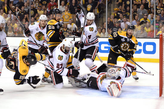 BOSTON, MA - JUNE 24: Goalie Corey Crawford #50 of the Chicago Blackhawks reaches to make a save as Tyler Seguin #19 of the Boston Bruins is up ended in front of the net in the first period  in Game Six of the 2013 NHL Stanley Cup Final at TD Garden on June 24, 2013 in Boston, Massachusetts.  (Photo by Harry How/Getty Images)