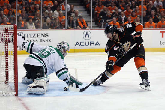 ANAHEIM, CA - APRIL 16:  Kyle Palmieri #21 of the Anaheim Ducks slides the puck under the stick of goaltender Kari Lehtonen #32 of the Dallas Stars for a goal in the first period of Game One of the First Round of the 2014 NHL Stanley Cup Playoffs at Honda Center on April 16, 2014 in Anaheim, California.  (Photo by Jeff Gross/Getty Images)