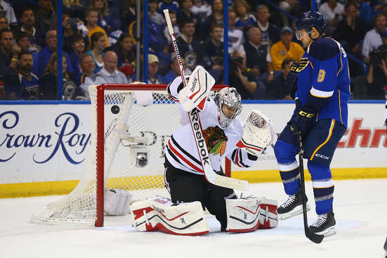ST. LOUIS, MO - APRIL 19: Corey Crawford #50 of the Chicago Blackhawks attempts to make a save as the puck hits the post while Jaden Schwartz #9 of the St. Louis Blues looks on in Game Two of the First Round of the 2014 Stanley Cup Playoffs at the Scottrade Center on April 19, 2014 in St. Louis, Missouri.  (Photo by Dilip Vishwanat/Getty Images)