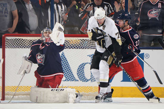 COLUMBUS, OH - APRIL 21: Goaltender Sergei Bobrovsky #72 of the Columbus Blue Jackets makes a glove save as Evgeni Malkin #71 of the Pittsburgh Penguins and Ryan Murray #27 of the Columbus Blue Jackets battle for position during the first period in Game Three of the First Round of the 2014 Stanley Cup Playoffs on April 21, 2014 at Nationwide Arena in Columbus, Ohio.  (Photo by Jamie Sabau/NHLI via Getty Images)