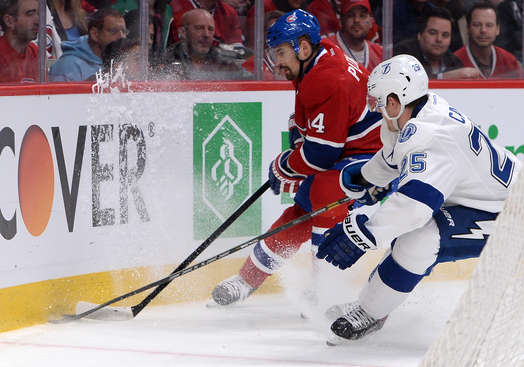 MONTREAL, QC - APRIL 22: Tomas Plekanec #14 of the Montreal Canadiens fights for the puck against Matthew Carle #25 of the Tampa Bay Lightning in Game Four of the First Round of the 2014 Stanley Cup Playoffs on April 22, 2014 at the Bell Centre in Montreal, Quebec, Canada. (Photo by Francois Lacasse/NHLI via Getty Images)