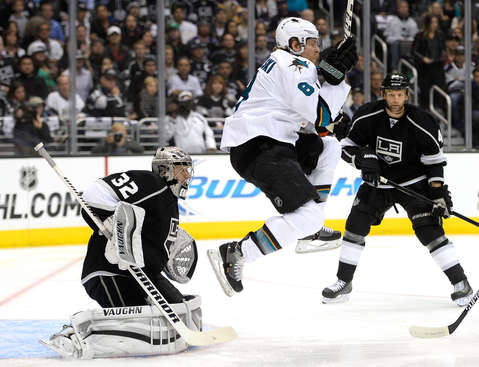 LOS ANGELES, CA - APRIL 22:  Joe Pavelski #8 of the San Jose Sharks jumps out of the way of a shot from Brent Burns #88 resulting in a goal in front of Jonathan Quick #32 and Robyn Regehr #44 during the first period in Game Three of the First Round of the 2014 NHL Stanley Cup Playoffs at Staples Center on April 22, 2014 in Los Angeles, California.  (Photo by Harry How/Getty Images)