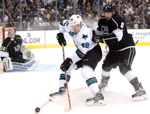 LOS ANGELES, CA - APRIL 28:  Tomas Hertl #48 of the San Jose Sharks controls the puck as Drew Doughty #8 of the Los Angeles Kings defends while Jonathan Quick #32 looks on during the first period in Game Six of the First Round of the 2014 NHL Stanley Cup Playoffs at Staples Center on April 28, 2014 in Los Angeles, California.  (Photo by Harry How/Getty Images)
