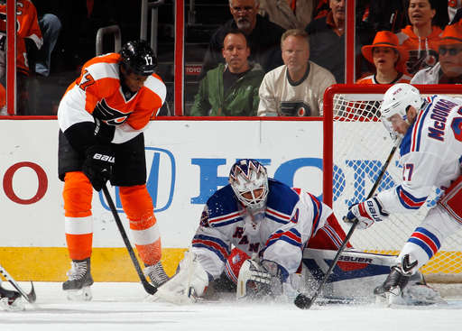 PHILADELPHIA, PA - APRIL 29: Wayne Simmonds #17 of the Philadelphia Flyers takes the shot against Henrik Lundqvist #30 of the New York Rangers during the first period in Game Six of the First Round of the 2014 NHL Stanley Cup Playoffs at the Wells Fargo Center on April 29, 2014 in Philadelphia, Pennsylvania.  (Photo by Bruce Bennett/Getty Images)