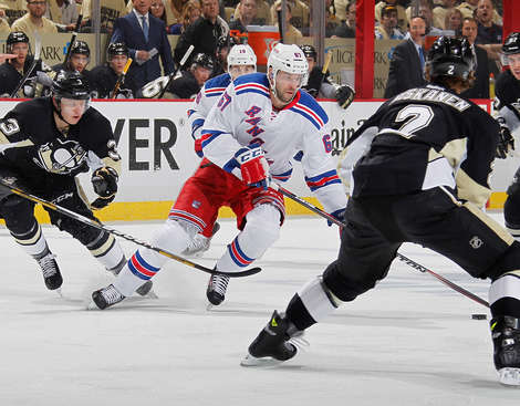 PITTSBURGH, PA - MAY 2:  Benoit Pouliot #67 of the New York Rangers moves the puck up ice between the defense of Olli Maatta #3 and Matt Niskanen #2 of the Pittsburgh Penguins in Game One of the Second Round of the 2014 Stanley Cup Playoffs at Consol Energy Center on May 2, 2014 in Pittsburgh, Pennsylvania.  (Photo by Gregory Shamus/NHLI via Getty Images)