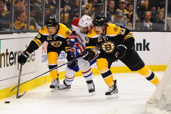 BOSTON, MA - MAY 10: Andrei Markov #79 of the Montreal Canadiens fights for the puck against Matt Fraser #25 and Loui Eriksson #21 of the Boston Bruins in Game Five of the Second Round of the 2014 Stanley Cup Playoffs at TD Garden on May 10, 2014 in Boston, Massachusetts. (Photo by Brian Babineau/NHLI via Getty Images)