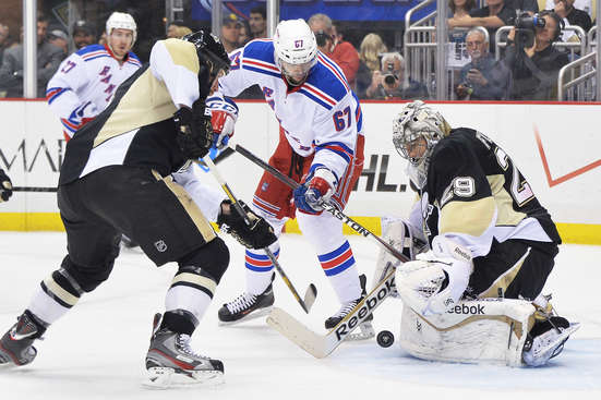 PITTSBURGH, PA - MAY 13:  Goaltender Marc-Andre Fleury #29 of the Pittsburgh Penguins makes a save late in the first period as Benoit Pouliot #67 of the New York Rangers looks for the rebound in Game Seven of the Second Round of the 2014 NHL Stanley Cup Playoffs on May 13, 2014 at CONSOL Energy Center in Pittsburgh, Pennsylvania.  (Photo by Jamie Sabau/Getty Images)