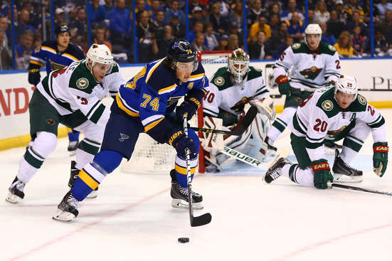ST. LOUIS, MO - APRIL 16: T.J. Oshie #74 of the St. Louis Blues skates with the puck against Charlie Coyle #3 and Ryan Suter #20 of the Minnesota Wild during Game One of the Western Conference Quarterfinals during the 2015 NHL Stanley Cup Playoffs at the Scottrade Center on April 16, 2015 in St. Louis, Missouri.  (Photo by Dilip Vishwanat/Getty Images)