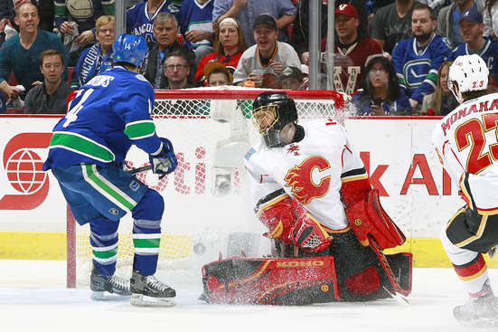 VANCOUVER, BC - APRIL 17:  Alexandre Burrows #14 of the Vancouver Canucks watches a shot by Daniel Sedin #22 beat Jonas Hiller #1 of the Calgary Flames for a goal during Game Two of the Western Conference Quarterfinals during the 2015 NHL Stanley Cup Playoffs at Rogers Arena on April 17, 2015 in Vancouver, British Columbia, Canada.  (Photo by Jeff Vinnick/NHLI via Getty Images)