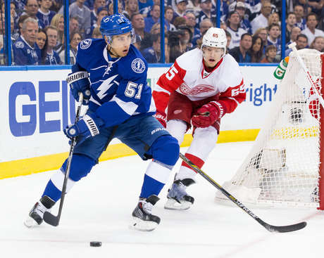 TAMPA, FL - APRIL 18: Valtteri Filppula #51 of the Tampa Bay Lightning controls the puck against Danny DeKeyser #65 of the Detroit Red Wings during the first period in Game Two of the Eastern Conference Quarterfinals during the 2015 NHL Stanley Cup Playoffs at the Amalie Arena on April 18, 2015 in Tampa, Florida.  (Photo by Scott Audette/NHLI via Getty Images)