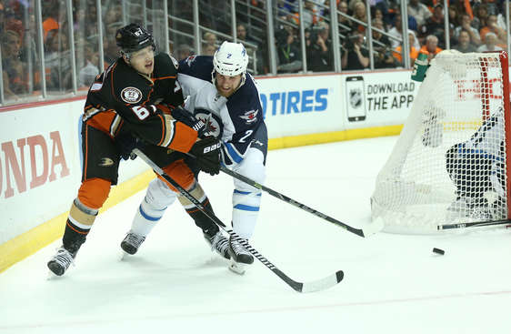 ANAHEIM, CA - APRIL 18:   Rickard Rakell #67 of the Anaheim Ducks and Keaton Ellerby #7 of the Winnipeg Jets battle for the puck in Game Two of the Western Conference Quarterfinals during the 2015 NHL Stanley Cup Playoffs at Honda Center on April 18, 2015 in Anaheim, California.  (Photo by Stephen Dunn/Getty Images)