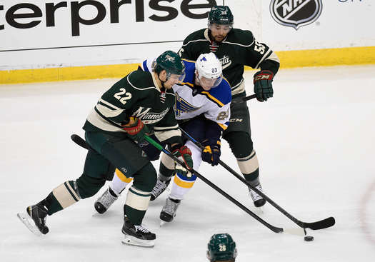 ST PAUL, MN - APRIL 20:  Dmitrij Jaskin #23 of the St. Louis Blues controls the puck against Nino Niederreiter #22 and Matt Dumba #55 of the Minnesota Wild during the first period in Game Three of the Western Conference Quarterfinals during the 2015 NHL Stanley Cup Playoffs on April 20, 2015 at Xcel Energy Center in St Paul, Minnesota. (Photo by Hannah Foslien/Getty Images)