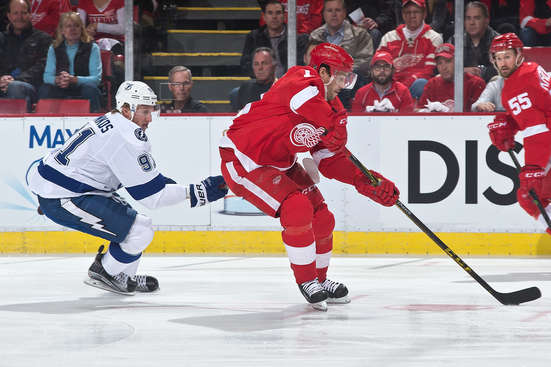 DETROIT, MI - APRIL 21: Steven Stamkos #91 of the Tampa Bay Lightning ties up Pavel Datsyuk #13 of the Detroit Red Wings as he skates up ice during the first period in Game Three of the Eastern Conference Quarterfinals during the 2015 NHL Stanley Cup Playoffs on April 21, 2015 at Joe Louis Arena in Detroit, Michigan. (Photo by Dave Reginek/NHLI via Getty Images)