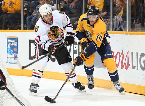 NASHVILLE, TN - APRIL 23: Mattias Ekholm #14 of the Nashville Predators looks to center the puck against Brent Seabrook #7 of the Chicago Blackhawks in Game Five of the Western Conference Quarterfinals during the 2015 NHL Stanley Cup Playoffs at Bridgestone Arena on April 23, 2015 in Nashville, Tennessee. (Photo by John Russell/NHLI via Getty Images)