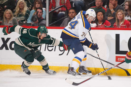 ST. PAUL, MN - APRIL 26: T.J. Oshie #74 of the St. Louis Blues skates with the puck while Jared Spurgeon #46 of the Minnesota Wild defends in Game Six of the Western Conference Quarterfinals during the 2015 NHL Stanley Cup Playoffs on April 26, 2015 at the Xcel Energy Center in St. Paul, Minnesota. (Photo by Bruce Kluckhohn/NHLI via Getty Images)